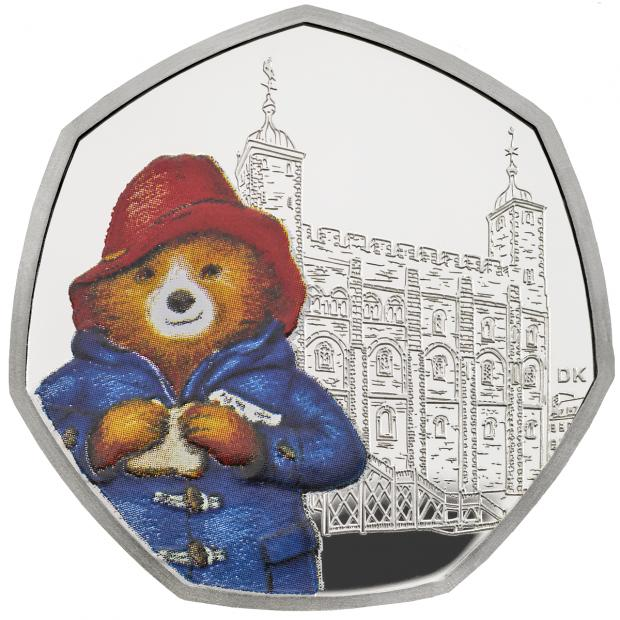 The Gazette: A silver proof coin shows Paddington Bear visiting the Tower of London (Royal Mint/PA)