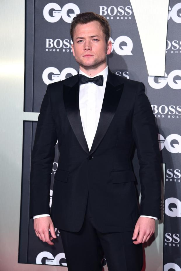The Gazette: Taron Egerton, who played Sir Elton John in the biopic Rocketman, wore a classy dark-coloured tuxedo on the carpet (Matt Crossick/PA)