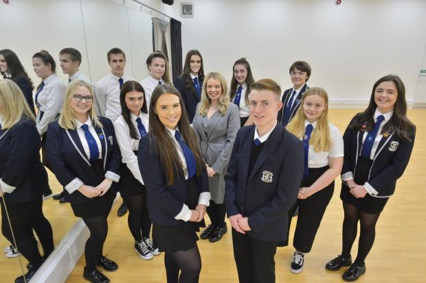 The Gazette: New head boy Tom Reid and head girl Erin Corner (front) with fellow pupils and headteacher Lynne Hollywood