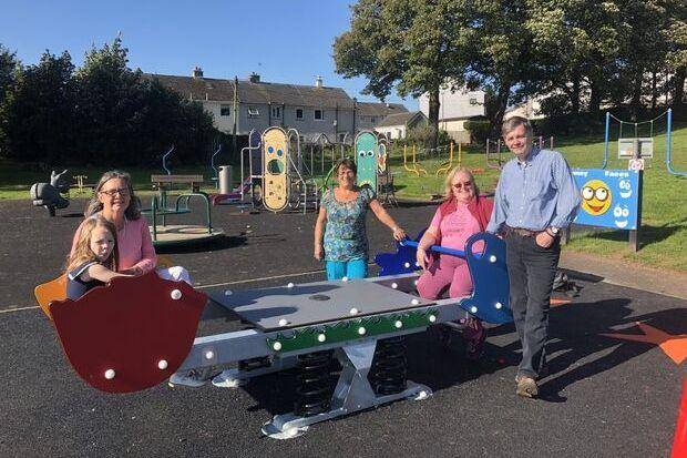 Tenants association members Eleanor Caldwell, left, Linda McClure, middle, Meg Gilzean and Chris Gilzean, right, are joined by youngster Alexis Stuart at Houston Road Park in Bridge of Weir