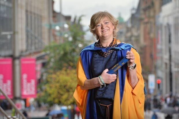 Corinne Hutton with her honorary degree from the Open University