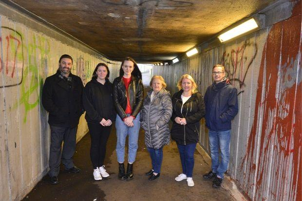 Councillor Andy Steel, Debbie Anderson, of Johnstone TOA, and artist Lauren Anderson with residents Irene Struthers, Jane Struthers and George MacDonald at the underpass linking Corseford with Spateston