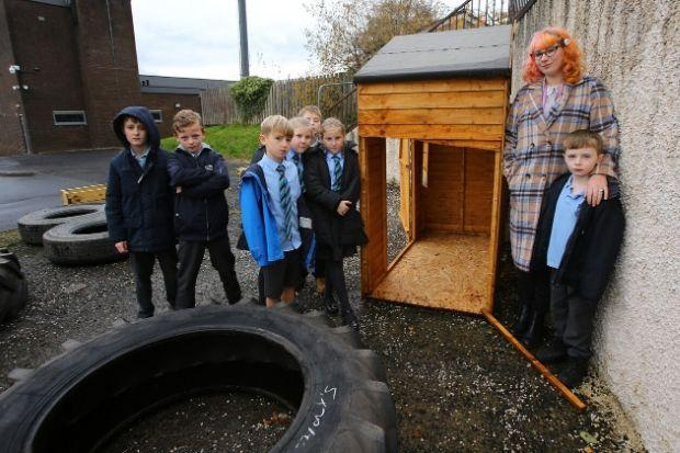 April Hamilton, teacher and leader of the gardening club at St Anthony's primary school, Johnstone pictured in the school's garden with pupils. The garden was vandalised on bonfire night