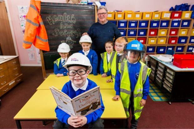 Ian Holden, of Taylor Wimpey, visited Our Lady of Peace Primary to teach pupils about health and safety issues