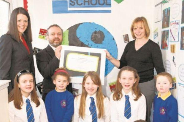 Councillor Brian Lawson presented the award to staff and pupils at Houston Primary