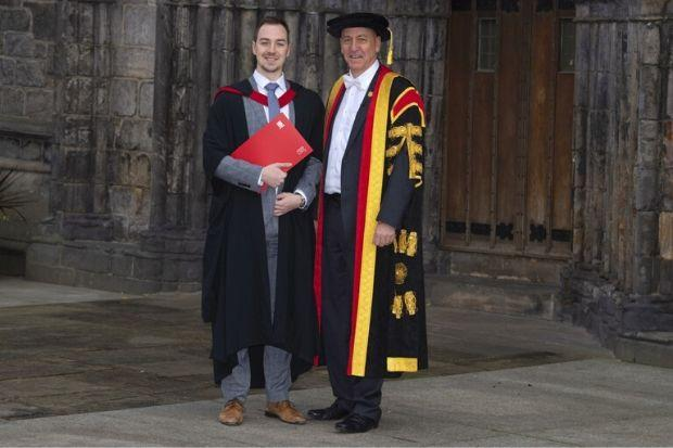 Andrew Campbell (left) is congratulated by Professor Craig Mahoney at the graduation ceremony