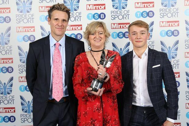 Corinne Hutton was presented with her award by Olympic rower James Cracknell (left) and fellow amputee Billy Monger, who was critically injured during an F4 race in 2017