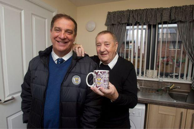 James, pictured with St Mirren chief executive Tony Fitzpatrick, was a ball boy at the very place he now lives