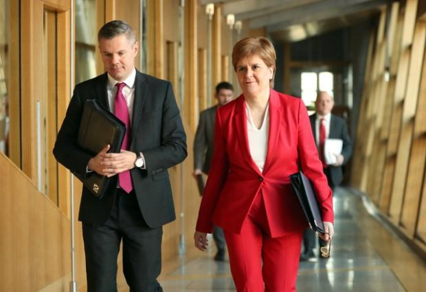 The Gazette: First Minister Nicola Sturgeon and Derek Mackay (PA)