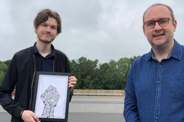 Kieran MacKenzie (left) is pictured with his artwork and Councillor Paul O'Kane