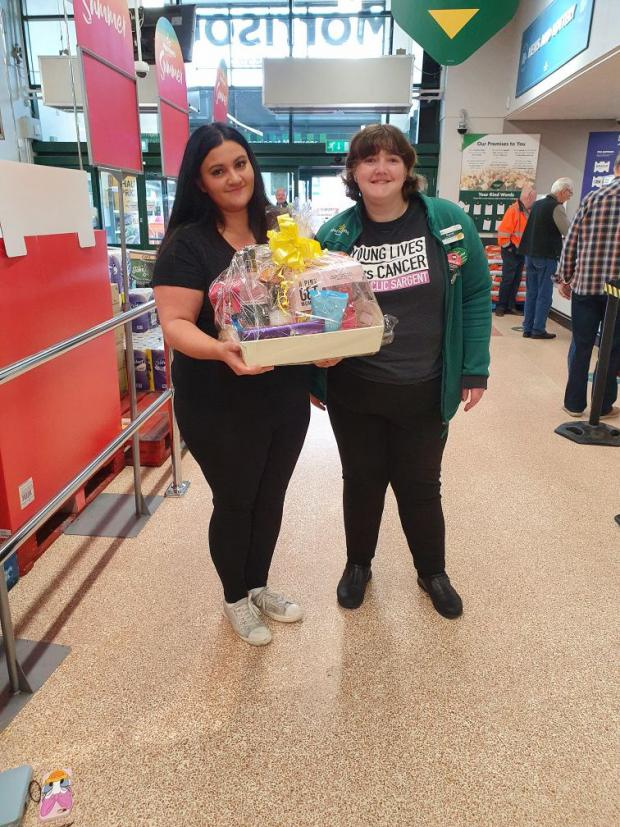 The Gazette: Lucky winner Shiree Singh Syan (left) collects her raffle prize from Elspeth Roxburgh