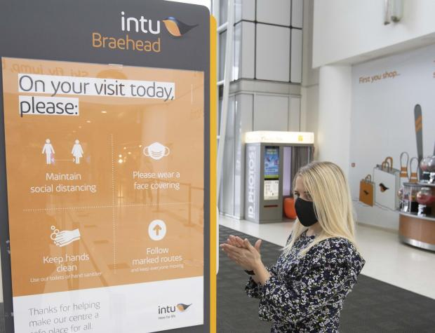 The Gazette: A visitor to intu Braehead uses one of the hand sanitisers that are available throughout the mall