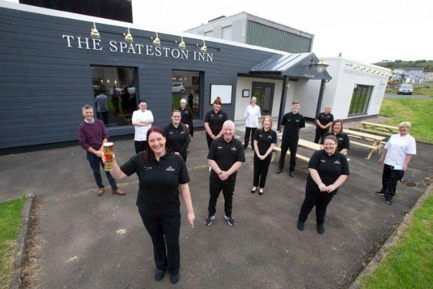 Manager Christine Knox and her staff welcome customers back to Spateston's only pub