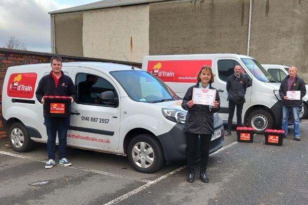 Grateful members of Food Train's Renfrewshire and East Renfrewshire branch with some of the sponsored boxes