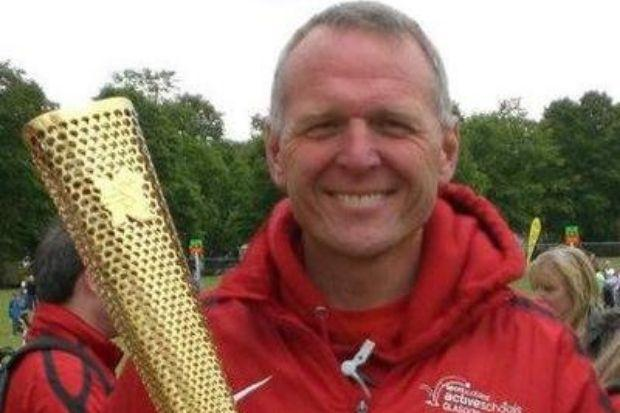 Highly-respected athlete John Kynaston with the torch that was used for the 2012 Olympic Games in London