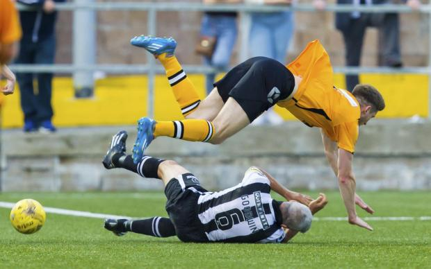 The Gazette: 18/08/15 PETROFAC TRAINING CUP 2ND RND ANNAN ATHLETIC v ST MIRREN GALABANK - ANNAN St Mirren's Jim Goodwin (grounded) slides in on Stuart McColm (35884824)