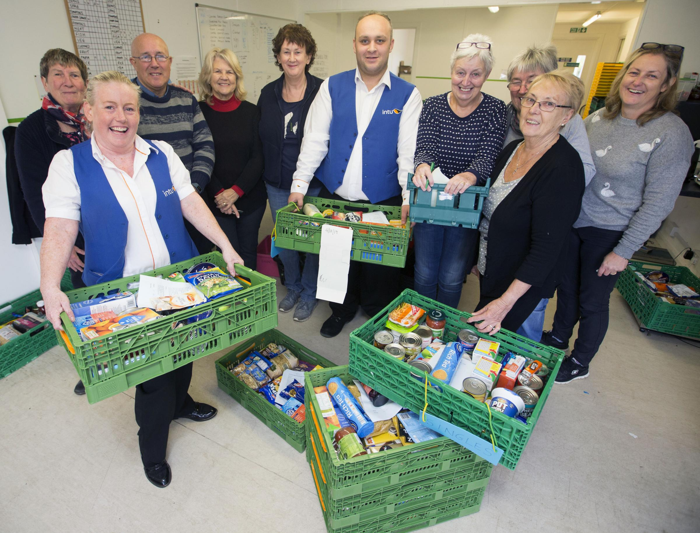 Volunteers from intu Braehead, Margaret Tazzar and Dennis Cuddihy with staff from Renfrewshire Foodbank Warehouse