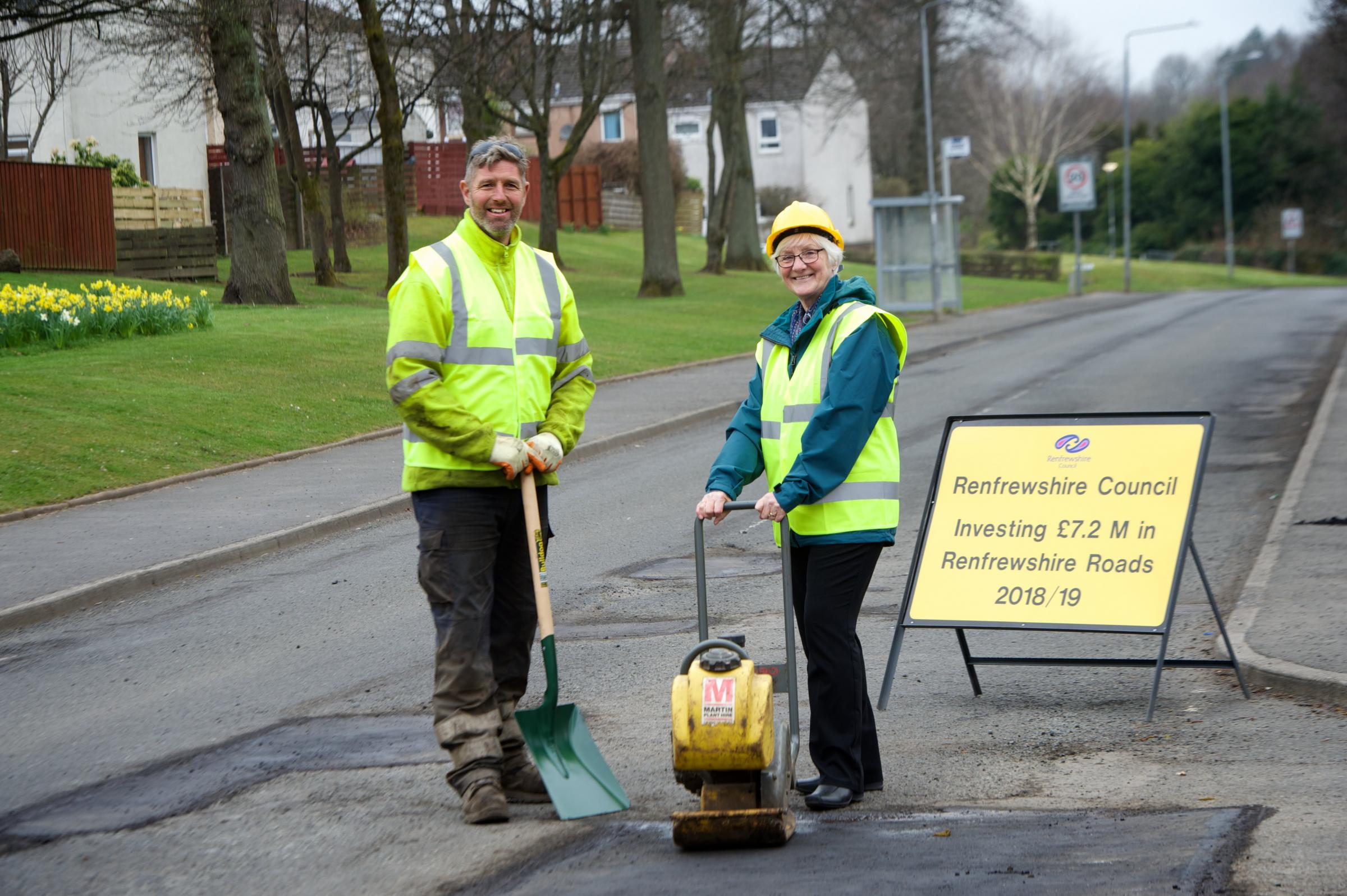 Roads worker Eric Philips with Councillor Cathy McEwan