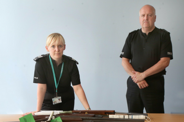 Officers with some of the weapons handed into them.