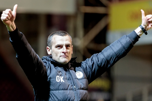 Buddies boss Owen Kearney salutes the away fans after the 1-0 win at Motherwell