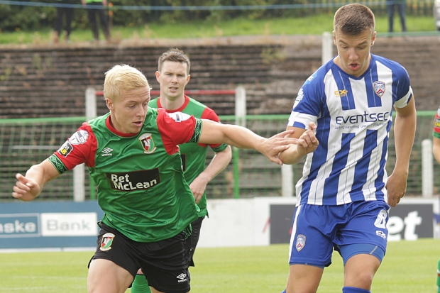 Brad Lyons (right) played just under 100 times for Coleraine