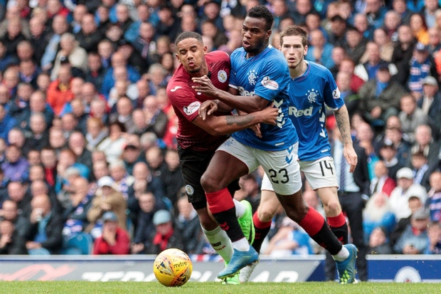 Cole Kpekawa is brushed off the ball by Rangers' Lassana Coulibaly
