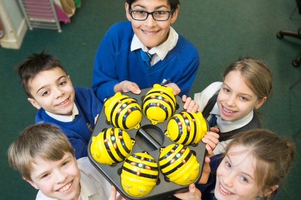 Houston Primary pupils with some of the BeeBots which have introduced them to coding