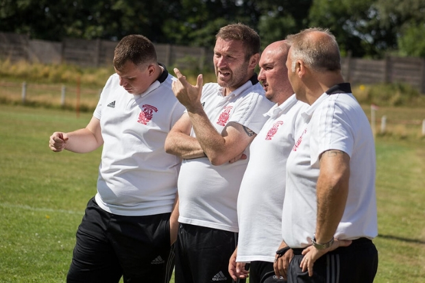 McKim (second from left) casting an eye over Burgh's many trialists along with assistant Davy Hill (second from right) and his coaching staff