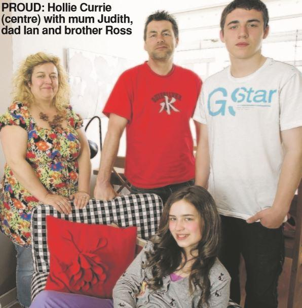 The Gazette: Hollie Currie (centre) with mum Judith, dad Ian, and brother Ross