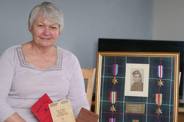Edith Stewart with her great-uncle's war medals and historic documents